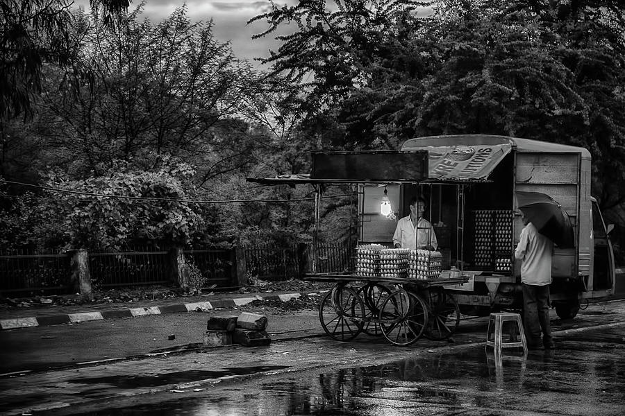 Asia Photograph - One Last Customer  by John Hoey