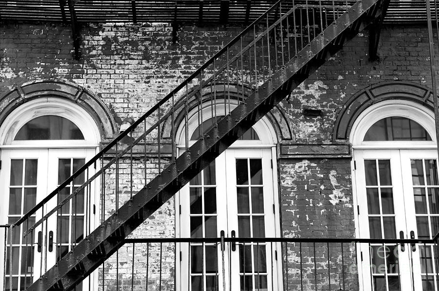 Fire Escape Photograph - One Way Down In Downtown Manhattan by John Rizzuto