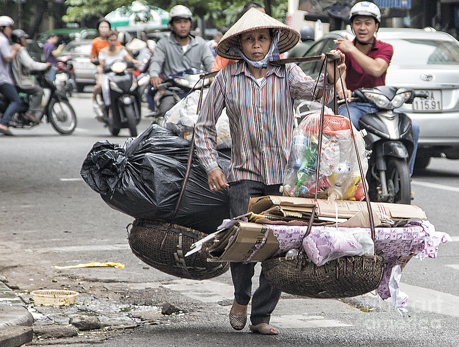 Vietnam Photograph - One Woman Street Life Hanoi by Chuck Kuhn