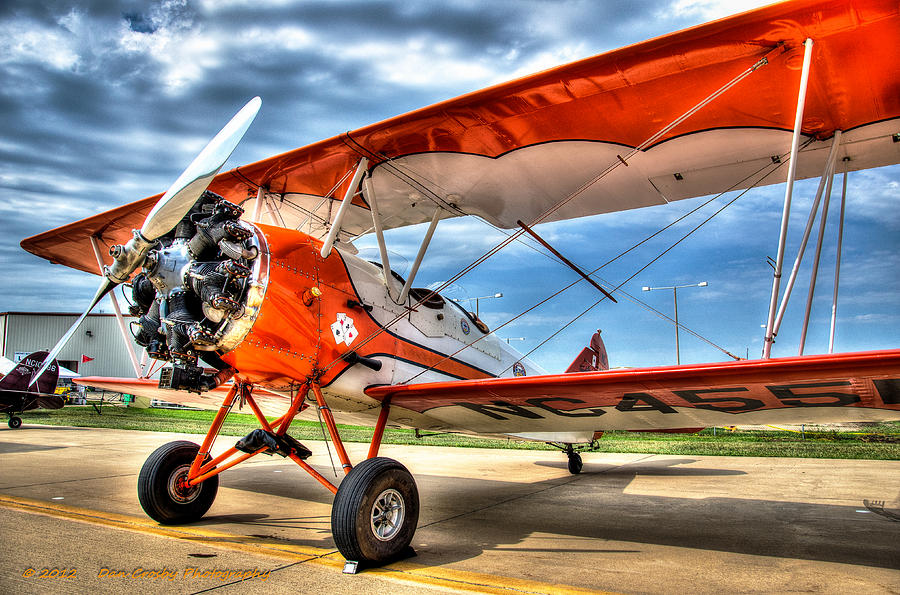 Airplane Photograph - Orange Bi-plane by Dan Crosby