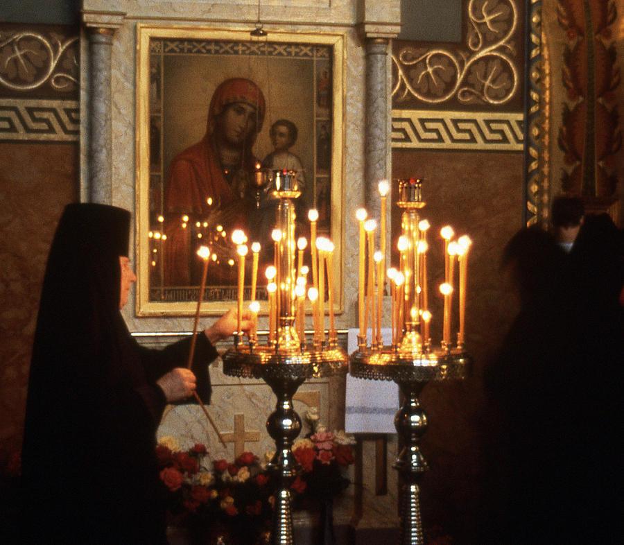 Orthodox Church Photograph - Orthodox Church Georgia Nuns Lighting Prayer Candles by Richard Singleton