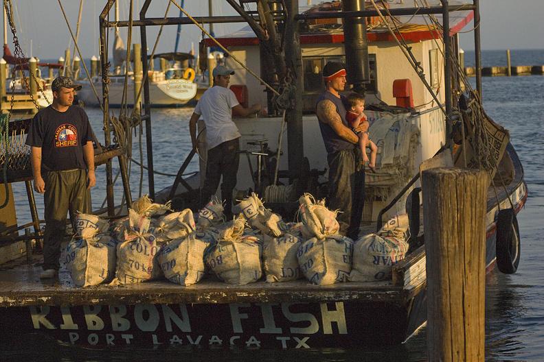 Water Photograph - Oyster Boat Docking Texas by Kelley Swinney