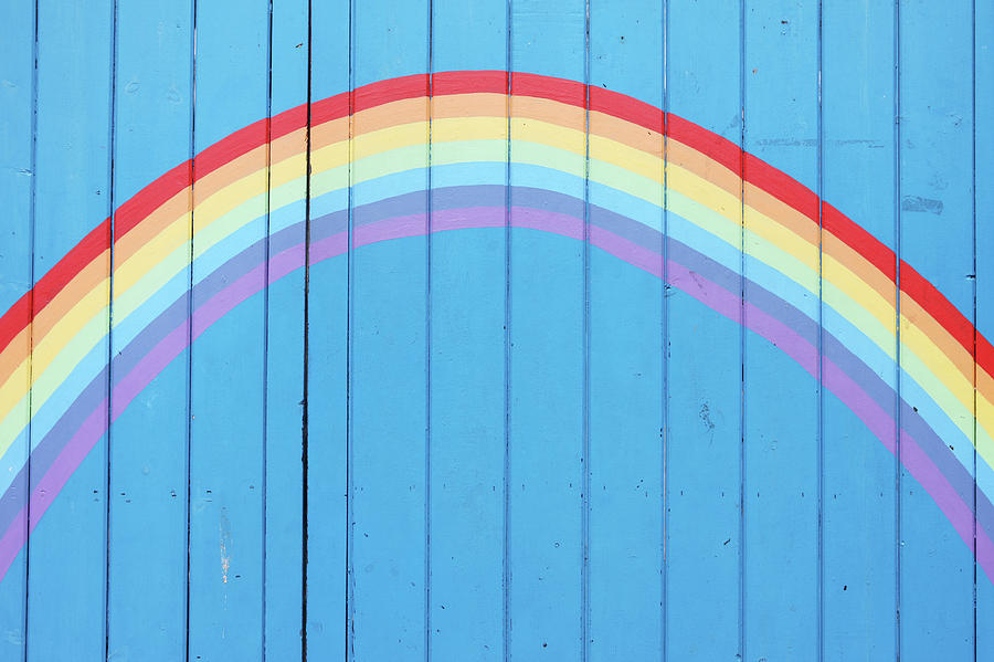 Horizontal Photograph - Painted Rainbow On Wooden Fence by Richard Newstead