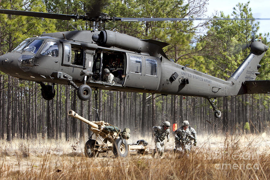 Uh-60m Photograph - Paratroopers Connect A Howitzer by Stocktrek Images