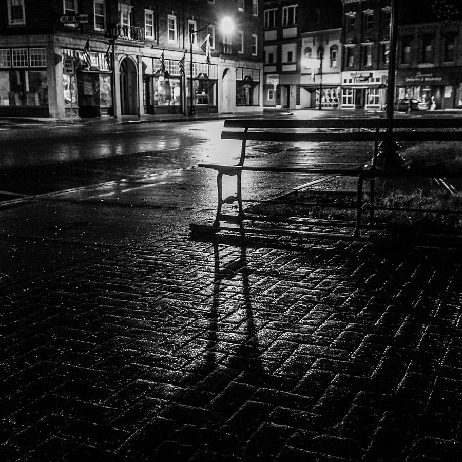 Park bench on a rainy night by Kendall McKernon