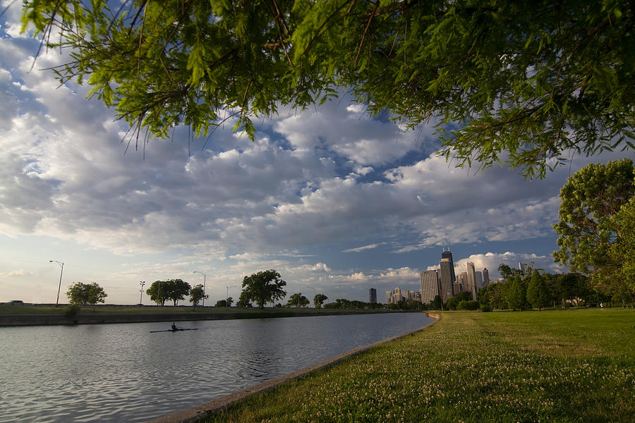 Rowing Photograph - Park Scene With Rower And Skyline by Sven Brogren