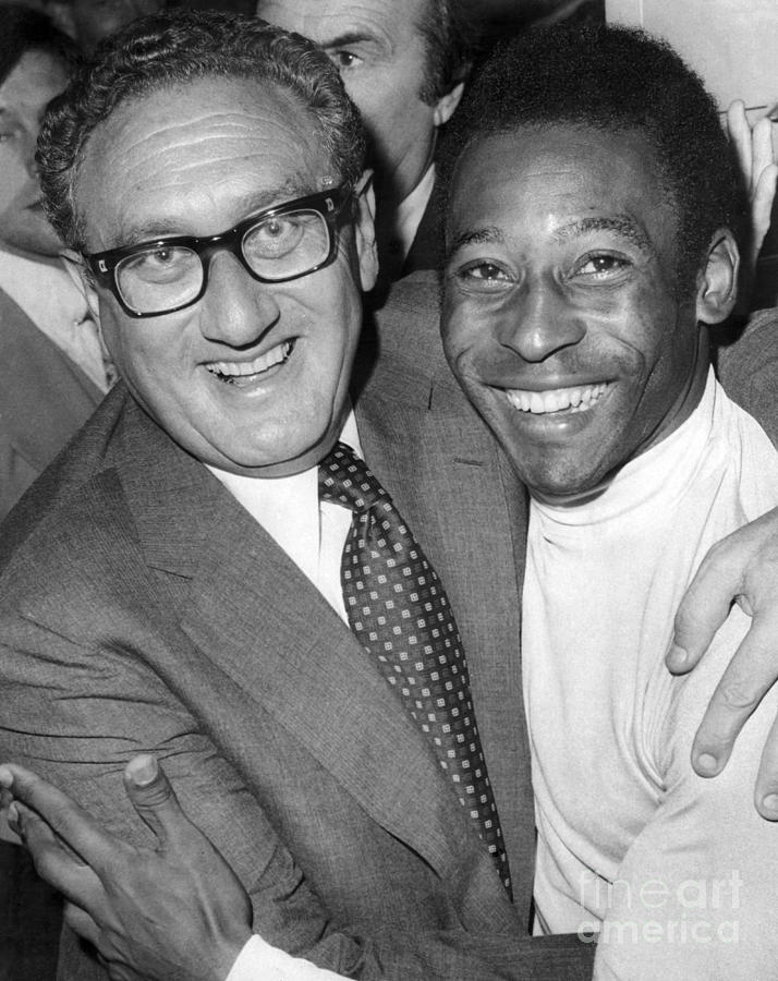 Pele enjoys a visit with Henry Kissinger in the NY Cosmos locker room. 1977 Photograph by William Jacobellis