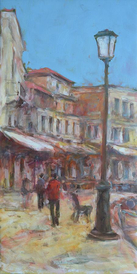 People Walking On Old Town Street