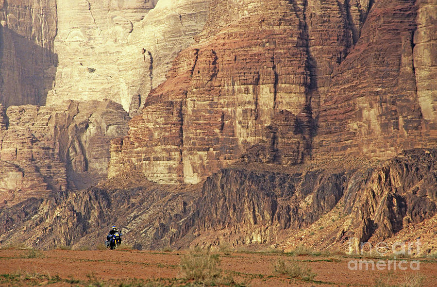 Alone Photograph - Person Riding A Motorbike Through The Wadi Rum Desert In Jordan by Sami Sarkis
