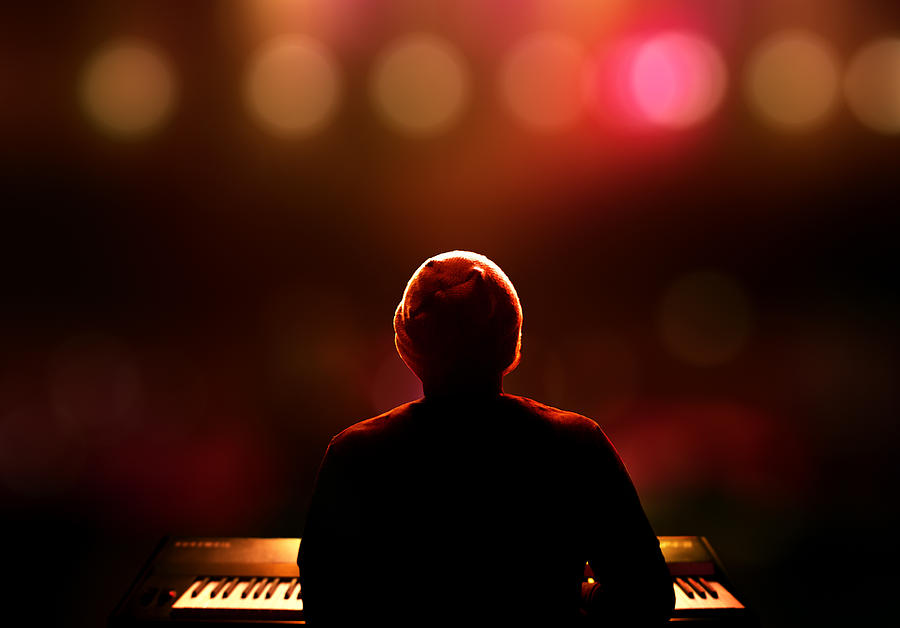 Pianist On Stage From Behind Photograph
