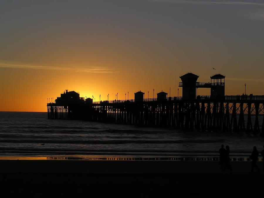Pier At Sunset Photograph by Chuck Cannova