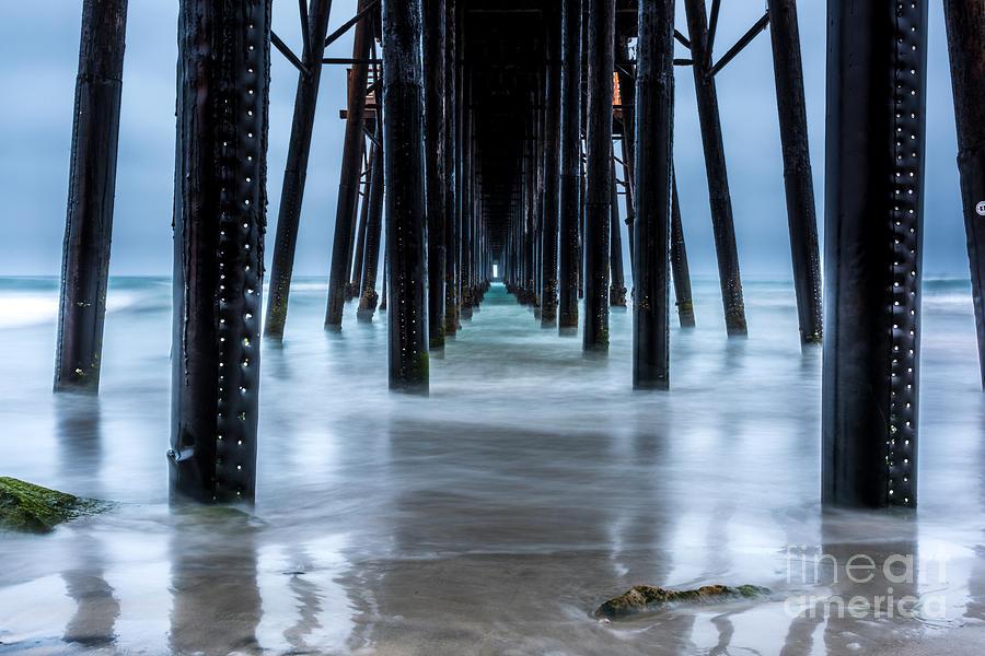 Ocean Photograph - Pier into the Ocean by Leo Bounds