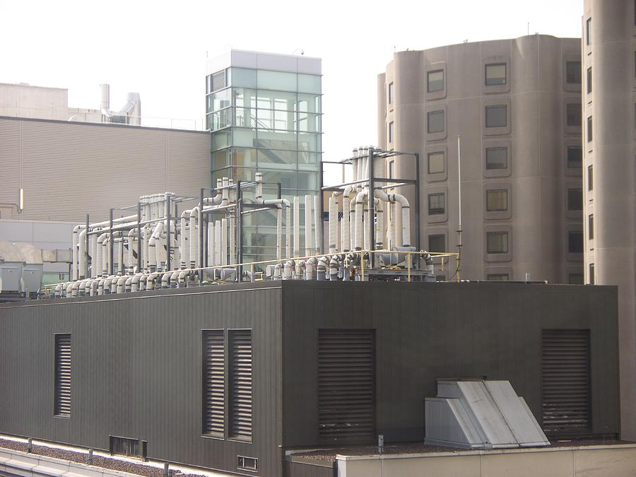 Cityscape Photograph - Piping On The Roof Top by Rosanne Bartlett