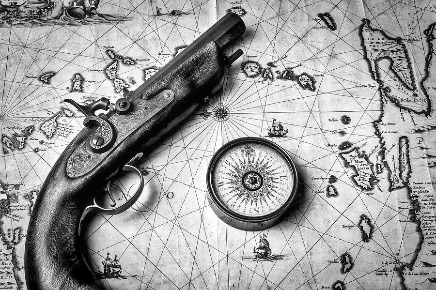 Pistole And Compass On Old Map In Black White Photograph By
