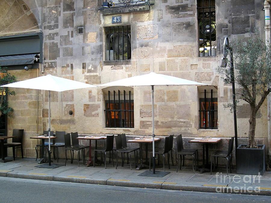 Paris Photograph - Place Des Victoires Cafe by Suzanne Krueger