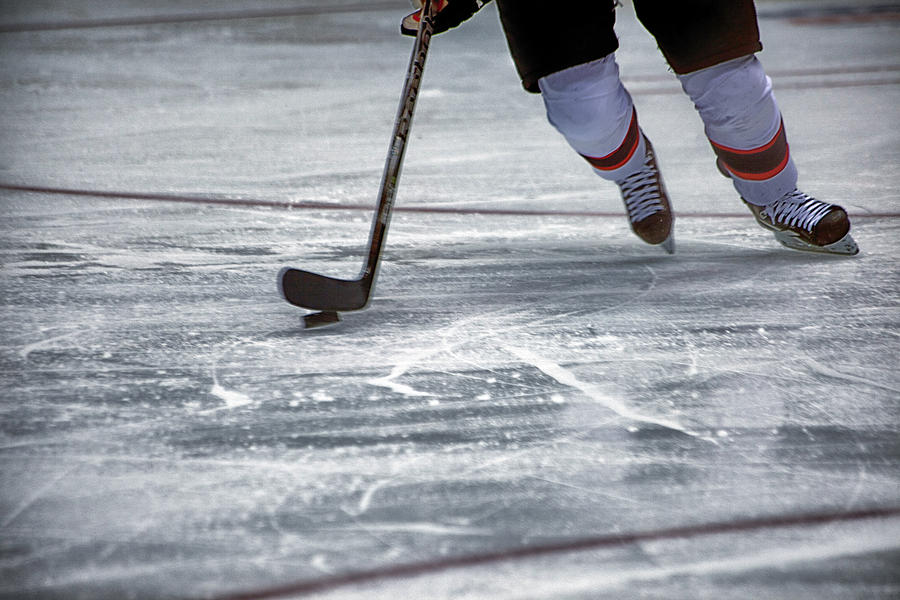 Hockey Photograph - Player And Puck by Karol Livote