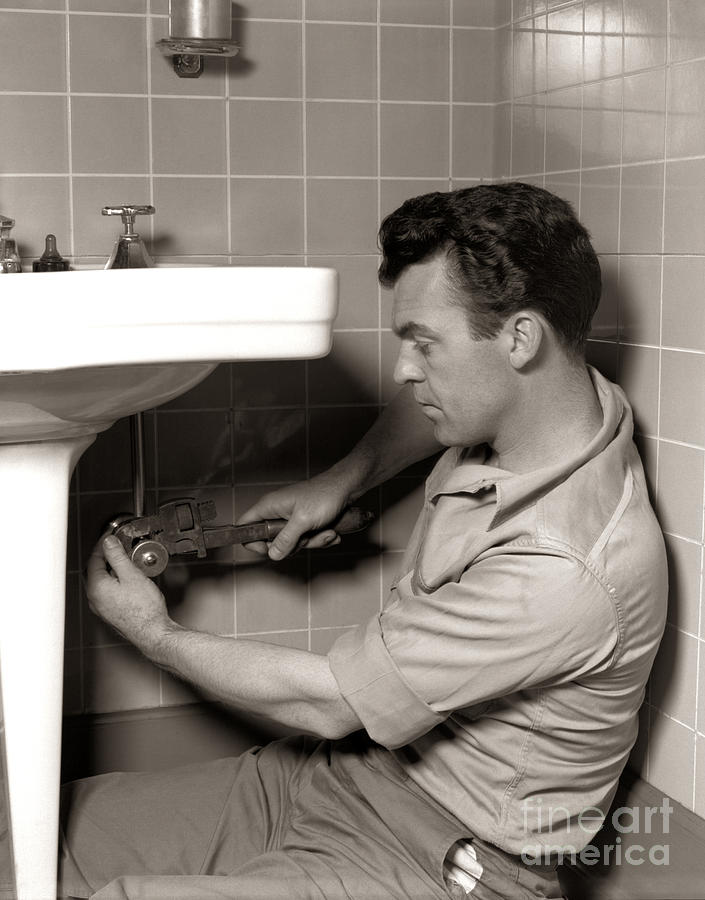 Plumber Fixing Bathroom Sink C 1950s Photograph By H Armstrong Roberts Classicstock