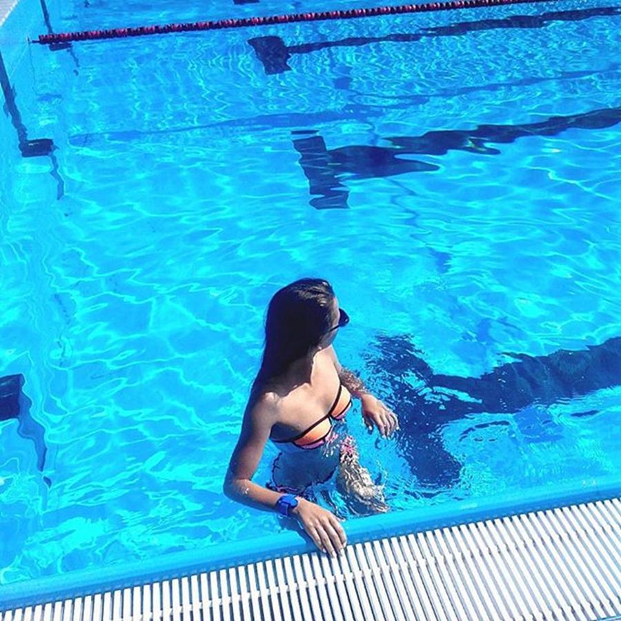 girls dancing nude in a swimming pool