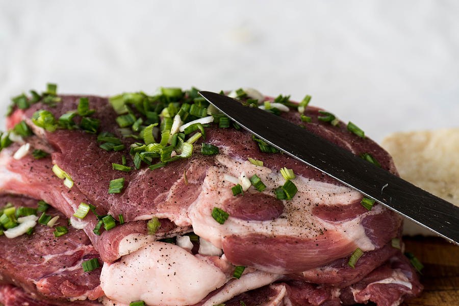 Background Photograph - Pork meat with green garlik and knife by Adrian Bud