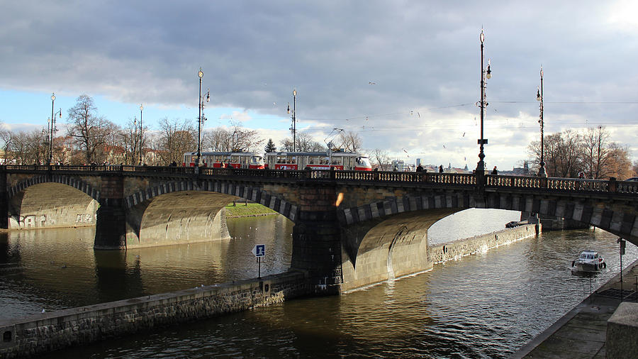 Prague tram on a bridge by Radka Zimova King