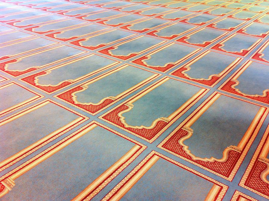 Horizontal Photograph - Prayer Mats Printed On Mosque Carpet by Jill Tindall