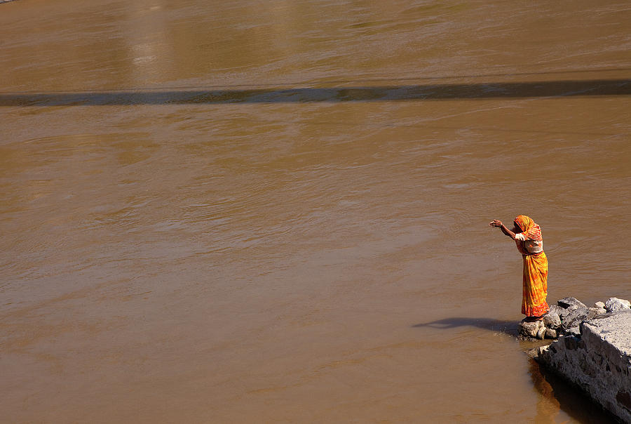Adult Photograph - Praying On  Banks Of Holy Ganges In Rishike by Claude Renault