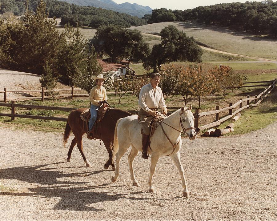 History Photograph - President And Nancy Reagan Horseback by Everett