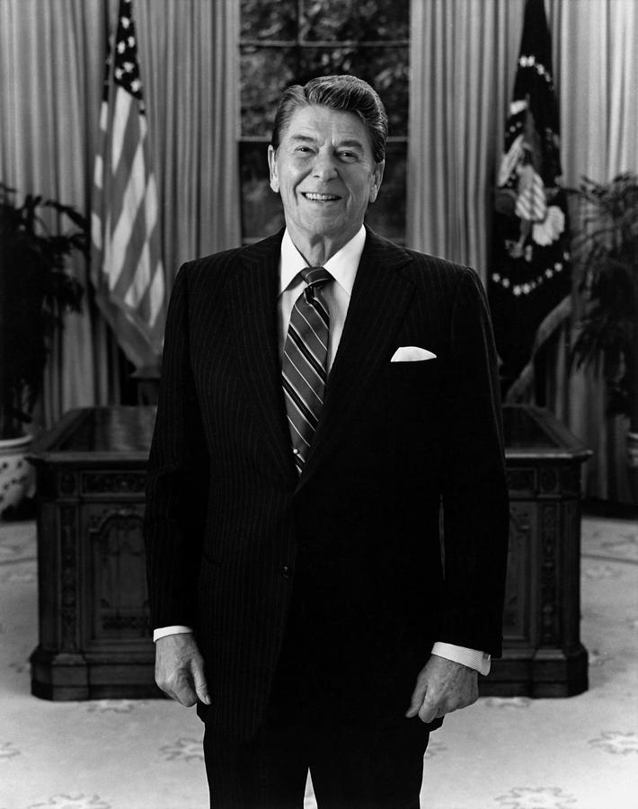 President Ronald Reagan In The Oval Office Photograph By War Is