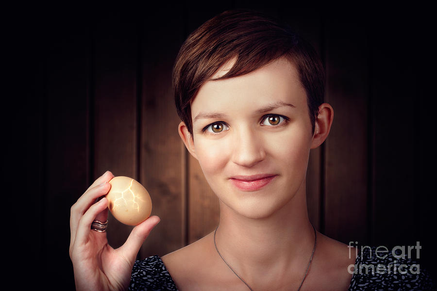 Egg Photograph - Pretty Young Brunette Woman Holding Hatching Egg by Jorgo Photography - Wall Art Gallery