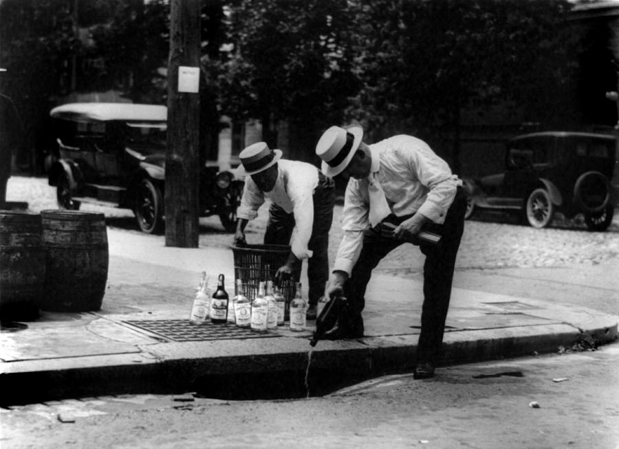 1920s Candid Photograph - Prohibition, Pouring Whiskey by Everett