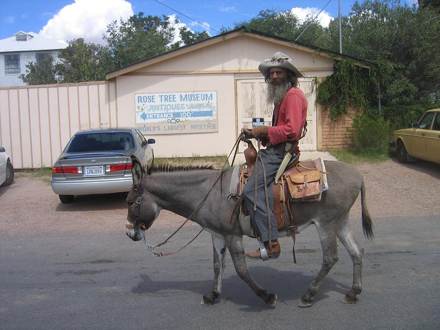 Prospector Re-enactor With Burro Passing Rose Bush Museum Sign Tombstone  Arizona 2004 Photograph by David Lee Guss