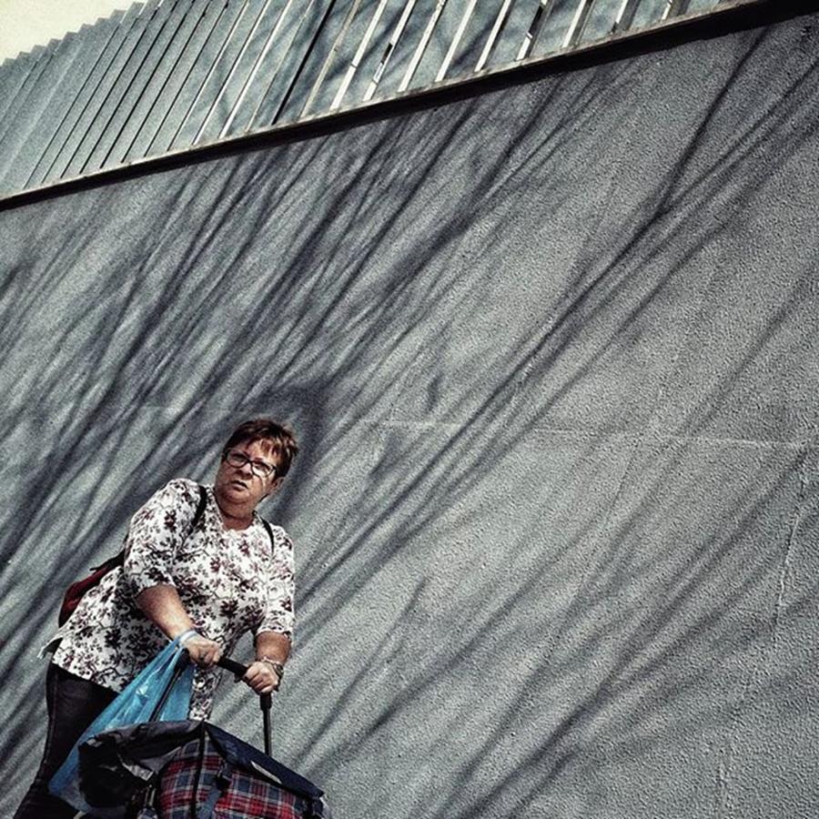 Street Photograph - Pushing Lady #woman #streetphotography by Rafa Rivas