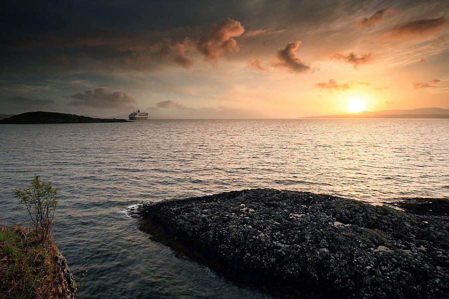 Ocean Liner Photograph - Queen Mary 2 Sunset Oban by Grant Glendinning