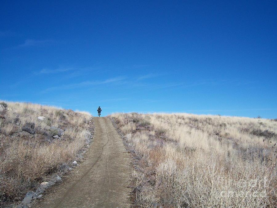 Racing Bike Photograph - Racing Over The Horizon by Heather Kirk