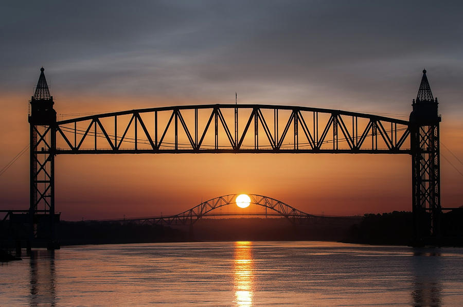 Railroad Bridge framing the Bourne Bridge during a sunrise by Ed Cabral