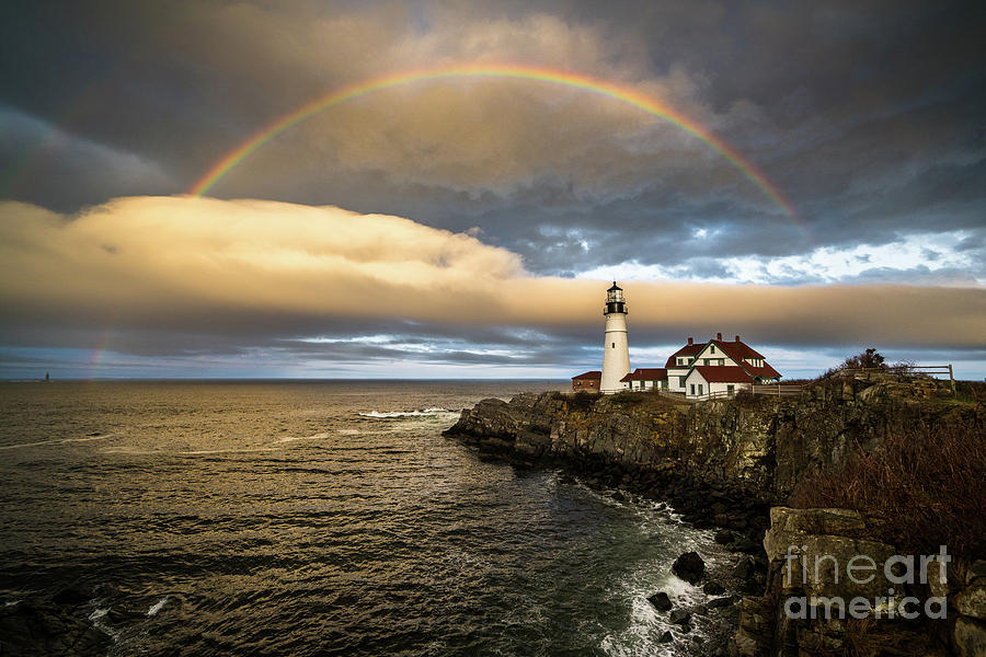 Attraction Photograph - Rainbow Over Portland Head Light by Benjamin Williamson