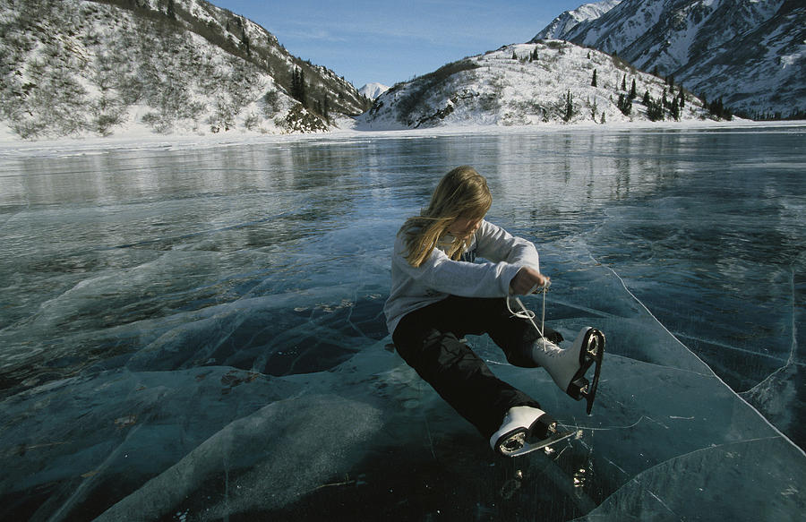 North America Photograph - Rebecca Quinton Laces Up Her Ice Skates by Michael S. Quinton