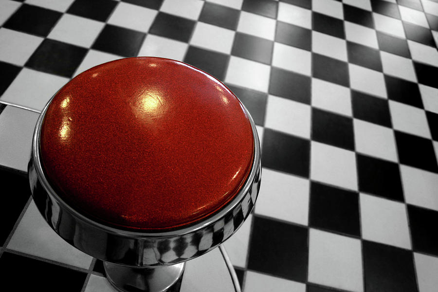 Horizontal Photograph - Red Cushion Stool Above Chequered Floor by Peter Young