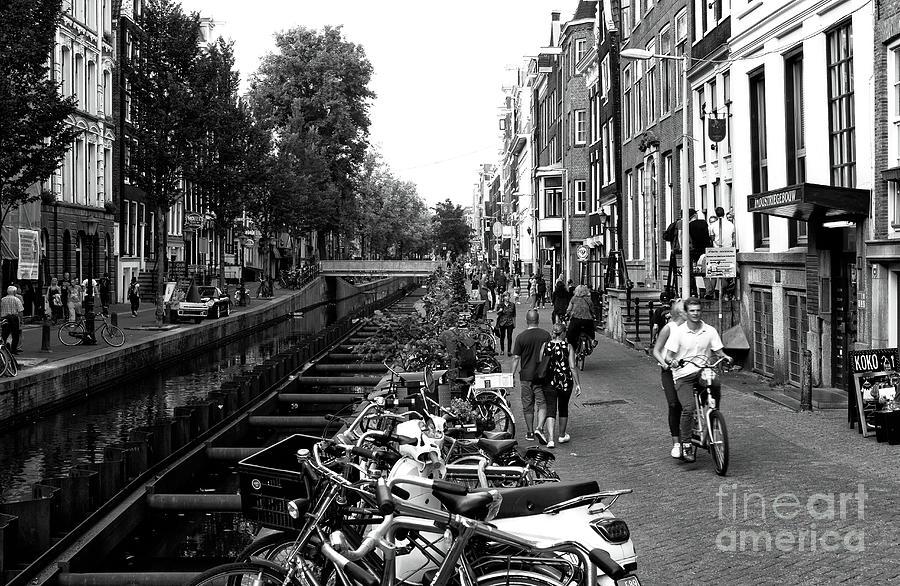 Bike Riding Photograph - Red Light Riding Mono by John Rizzuto