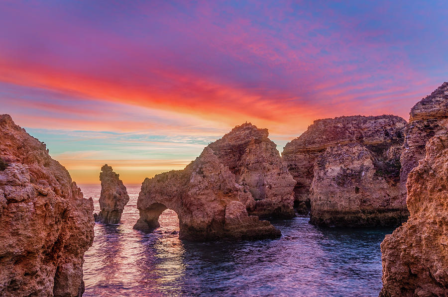 Red morning on Ponta da Piedade by Dmytro Korol