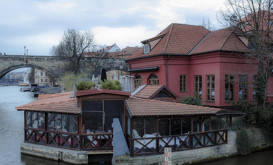 Charles Bridge Photograph - Red Restaurant On Vltava River by Marek Boguszak