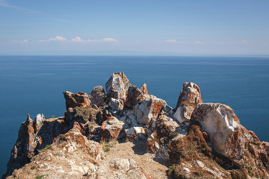 Red Rocks on Blue sky and water background by Sergey Taran