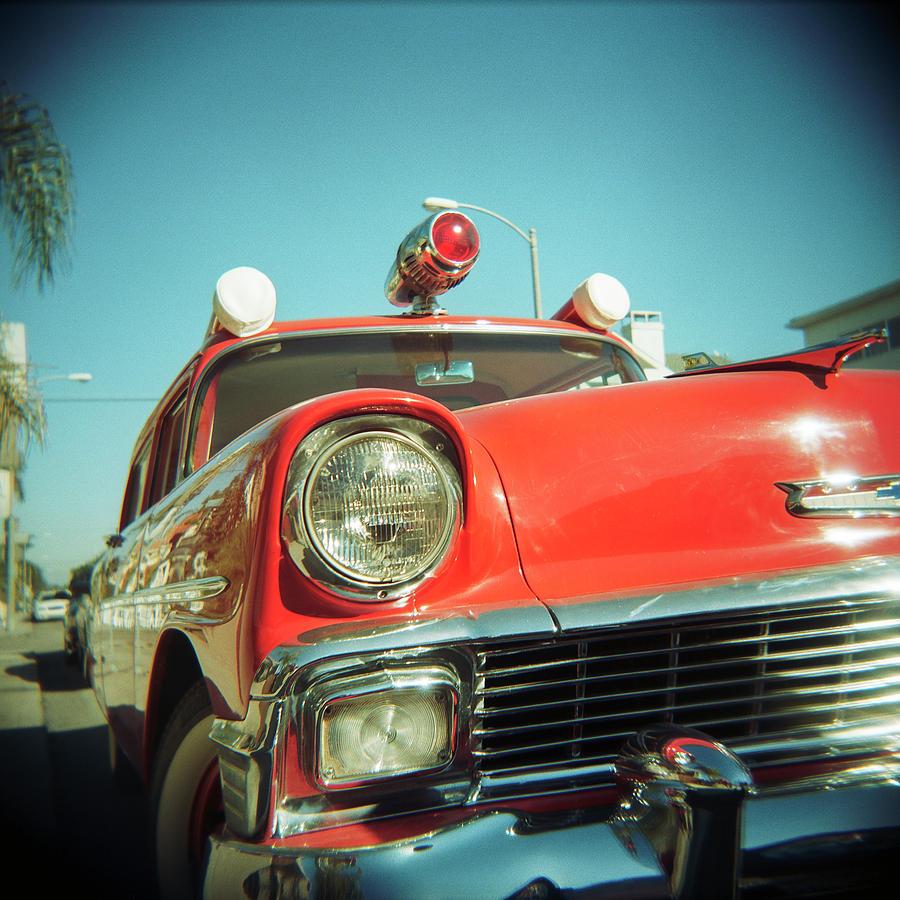 Red Vintage Ambulance by Sabine Konhaeuser