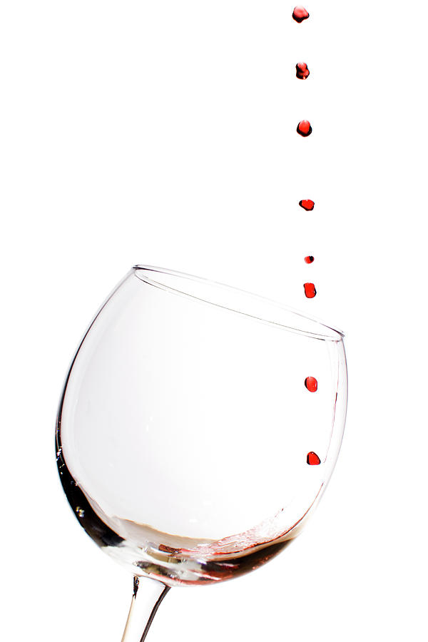 Red Wine Photograph - Red Wine Drops Into Wineglass by Dustin K Ryan