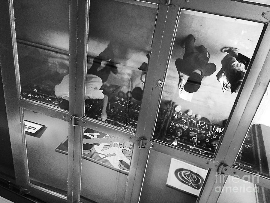 Reflections In An Overhead Door by Frank Merrem