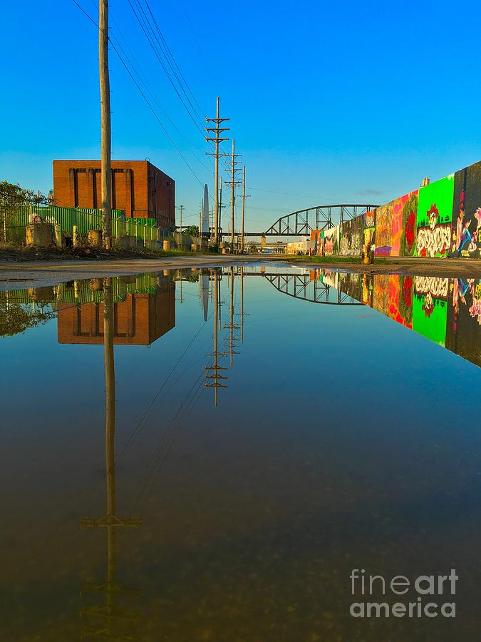 Reflections of graffiti and the Gateway Arch  by Debbie Fenelon
