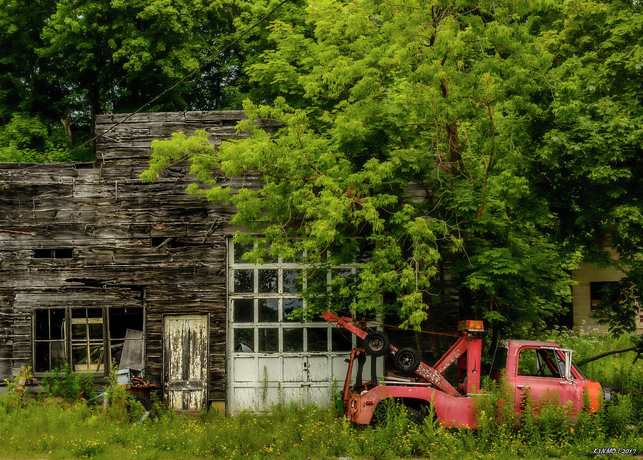Garage Photograph - Remains Of An Old Tow Truck And Garage by Ken Morris