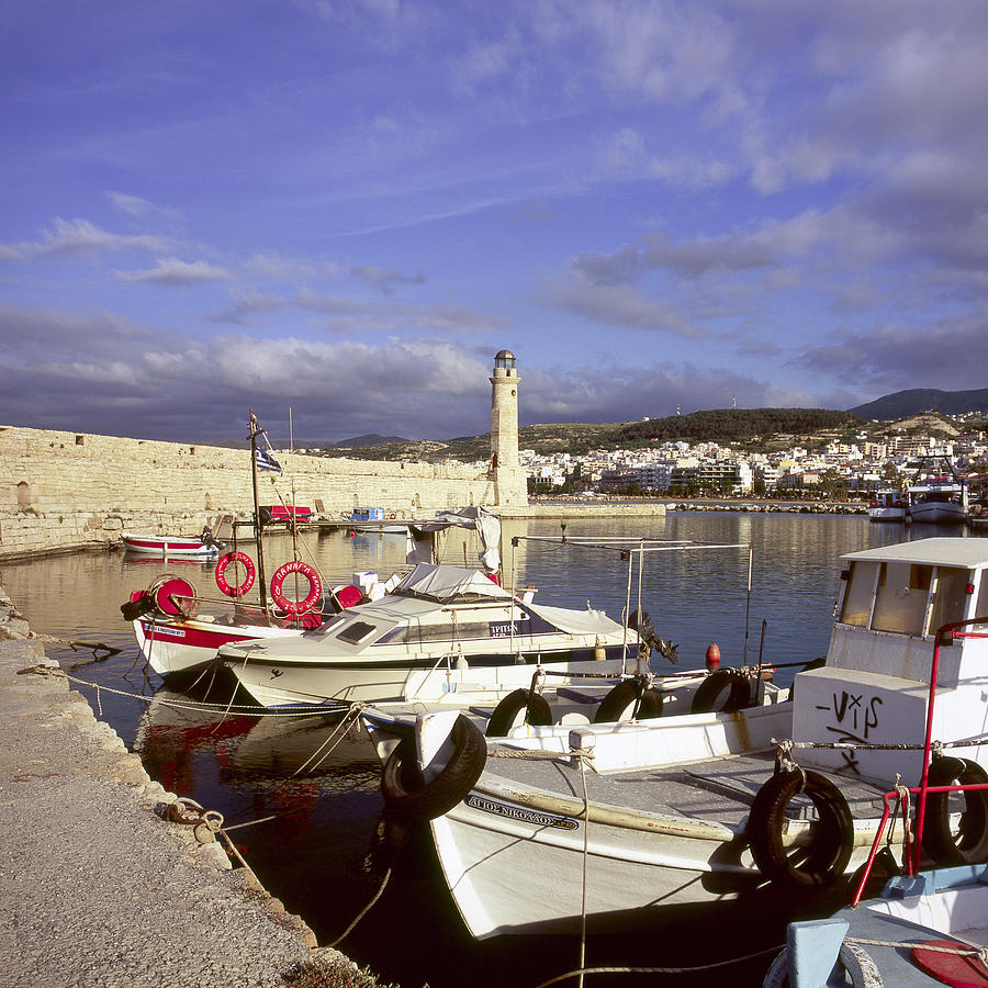 Rethymnon Photograph - Rethymno Harbour In Crete by Paul Cowan