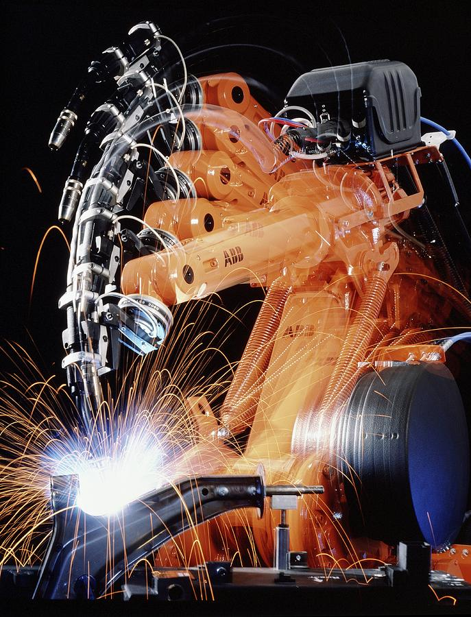 Spot Welding Photograph - Robot Arm Spot-welding A Car Suspension Unit by David Parker