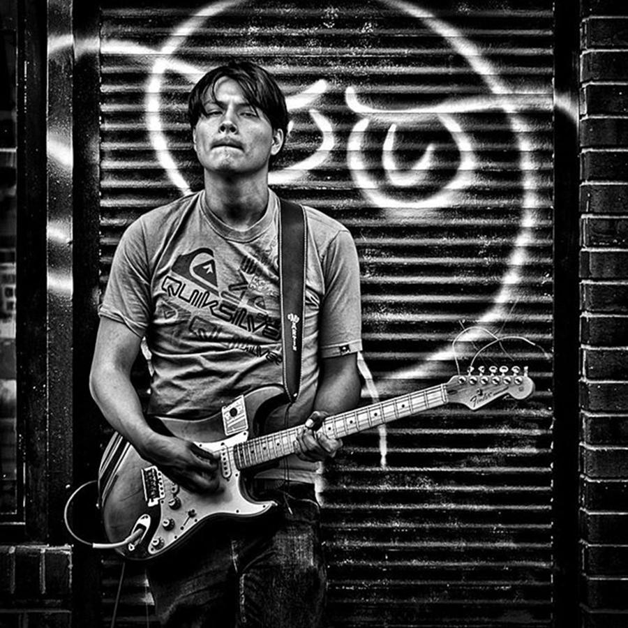 Toronto Photograph - Rock & Roll. Street Musician In by Brian Carson